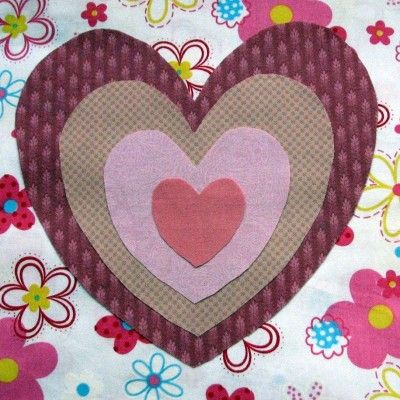 The set is designed to work within each other, as shown by the picture of hearts nested together and made using raw edge applique.  Very effective.
