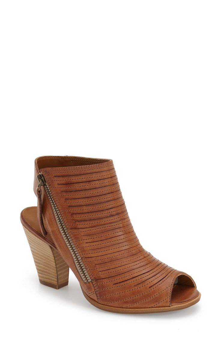 Love these brown leather sandals with an asymmetrical zipper and peep toe for a sophisticated look.