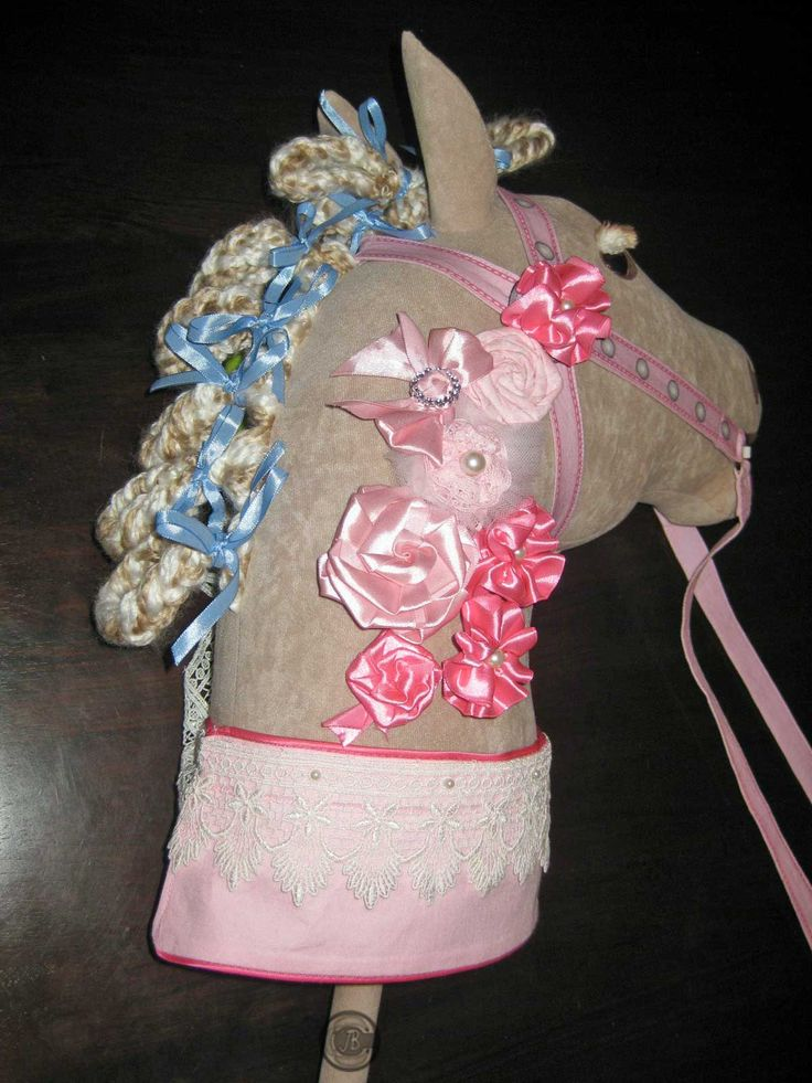 Maybe some Fabric Flowers on the neck of your Hobby Horse will give it  that Carousel style!
