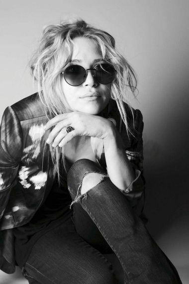 Mary-Kate Olsen in lennon sunglasses and a messy updo.