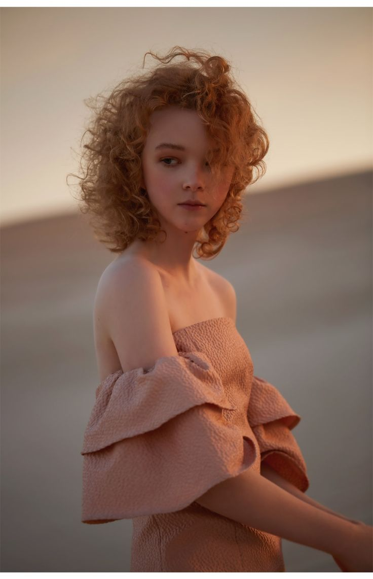 Pretty Magnolia sleeve details in Peach. See more here: https://whiterunway.com/magnolia-dress.html