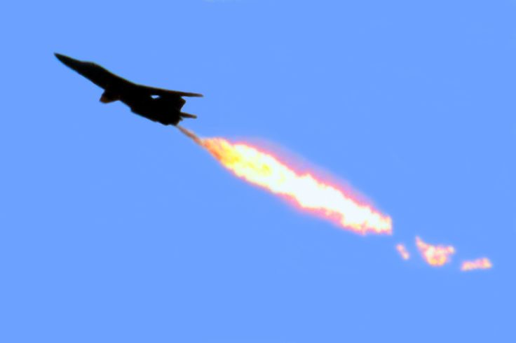 F1-11 fighter jet performing a fuel dump and burn.