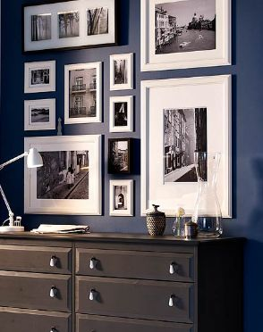 Gallery Style Artwork Arrangement -   Neat way to view many photos in a small space.