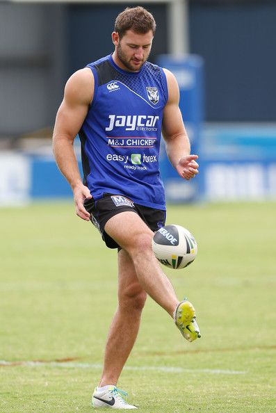 Mitch Brown kicks the ball during a Canterbury Bankstown Bulldogs NRL training session at Belmore Oval on March 13, 2014 in Sydney, Australi...
