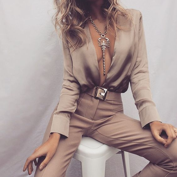 28 Gorgeous Bachelorette Outfits With A Wow Factor: #2. Nude jumpsuit with a statement necklace and a belt