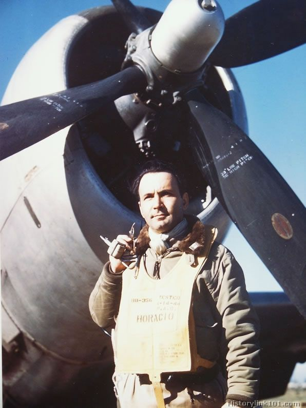 Pilot of the First Brazilian Fighter Squadron poses next to his P-47 Thunderbolt.