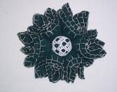 Green felt flower with white crochet