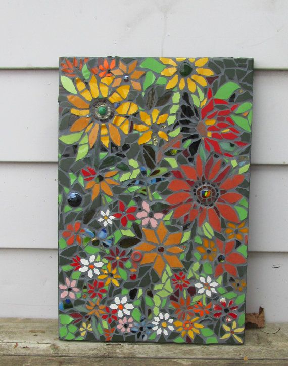 SHIPPING is FREE this weekend only! This Flower mosaic will brighten any room, or any covered outdoor space . This is a original very colourful mosaic. I handcut and aligned all the pieces lovingly on to a approx. 24x16 inches board.   I used dark grout, and the mosaic is sealed.. The edges are painted black, and the mosaic is ready to hang In your home. The mosaic is signed on the back by the artist. (me) lol.  Remember, if the shipping charges are any less than estimated, I will gladly…