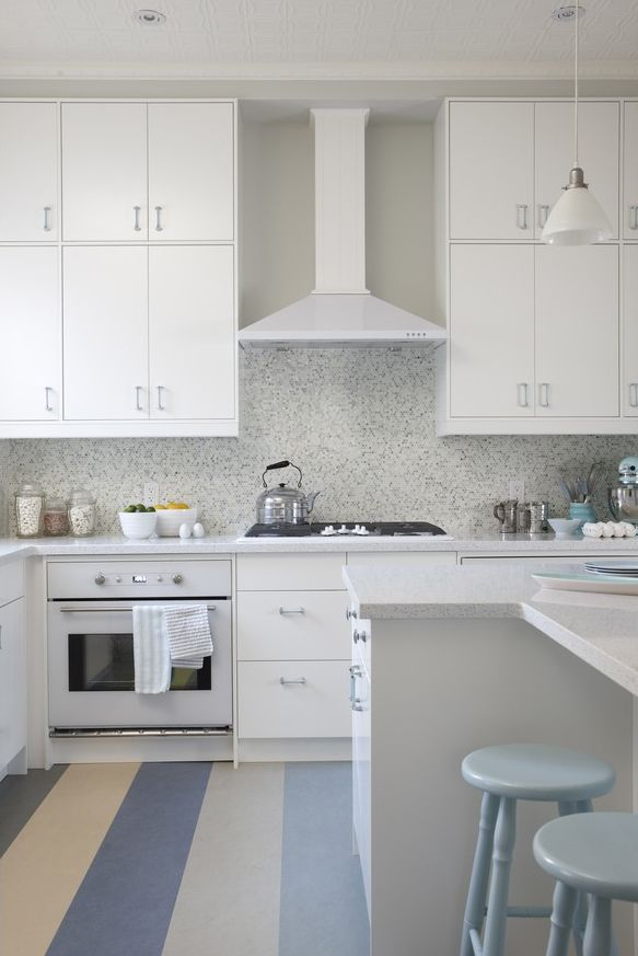 One of my favorite Sarah Richardson kitchens-and its an out of the box kitchen! Love the white with the hits of color. ... Not crazy about the floor though.
