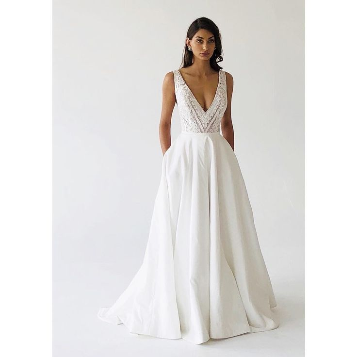 Our stunning 'Lucinda' gown! A-line taffeta gown with pockets and guipure lace, V-neck bodice. #love #happy #bridalstyle #bridestory #weddingday #weddingtime #wedding #weddingideas #bride #bridal #bridallook #bridetobe #amalinevitale