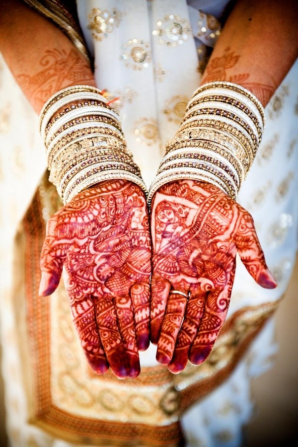 mehndi. traditionally, the groom has to find their initials hidden in the design before he can, well, you know ...