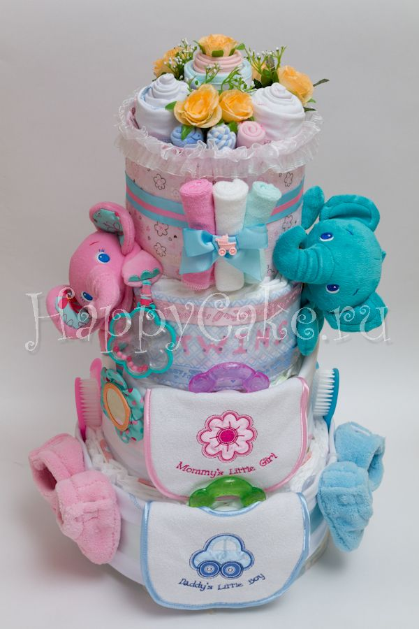 Торт из памперсов для двойняшек «Boy & Girl» - красивый, оригинальный, а главное функциональный подарок на рождение сразу двух малышей.