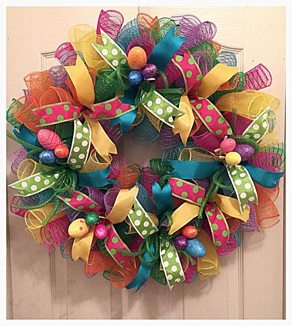 You will love decorating this spring when you display this colorful Easter Egg Deco Mesh Wreath.  It is made on a wired wreath form with high-quality pink, turquoise, orange, lavender, lime and yellow deco mesh.  There are numerous ribbons in polkadot and silky turquoise and yellow.