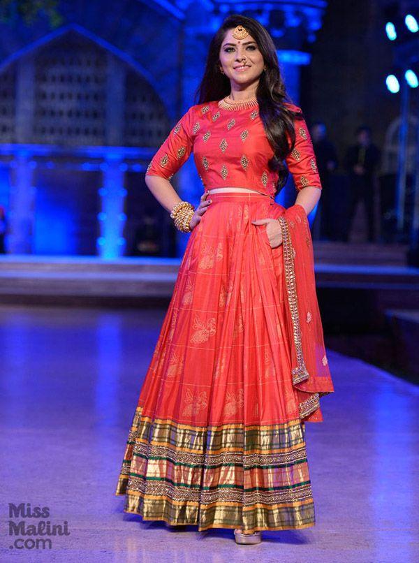 Simplistic elegance in this regal red lehenga by Neeta Lulla.