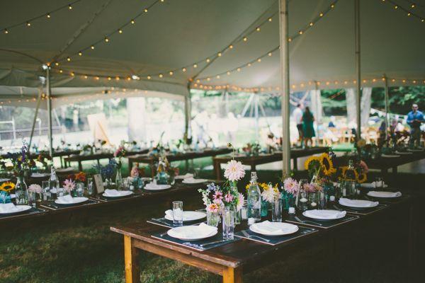 Tented backyard wedding with rustic farm tables and pretty lighting! | http://www.weddingpartyapp.com/blog/2014/10/29/boho-farm-table-wedding-katch-silva/