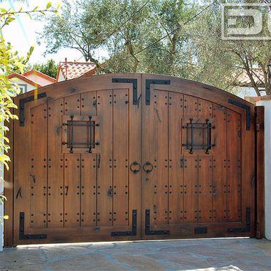 A laguna beach spanish style driveway gate in eco friendly composite materials gates doors for Wooden main gate design for home