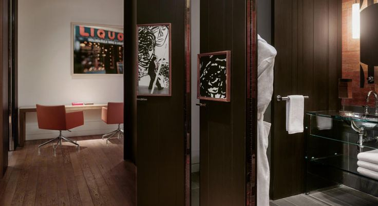 Contemporary interior design. Warm interior with a mix of earthy tones and orange highlights.