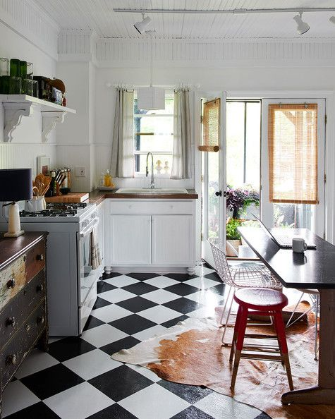 Older kitchens often lack the storage we've become accustomed to. In this renovated Victorian, the homeowners got creative, repurposing an old dresser and adding a freestanding hutch (not pictured) to compensate