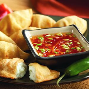 Cream Cheese Wontons With Sweet Chile, Scallion and Orange Dipping Sauce.