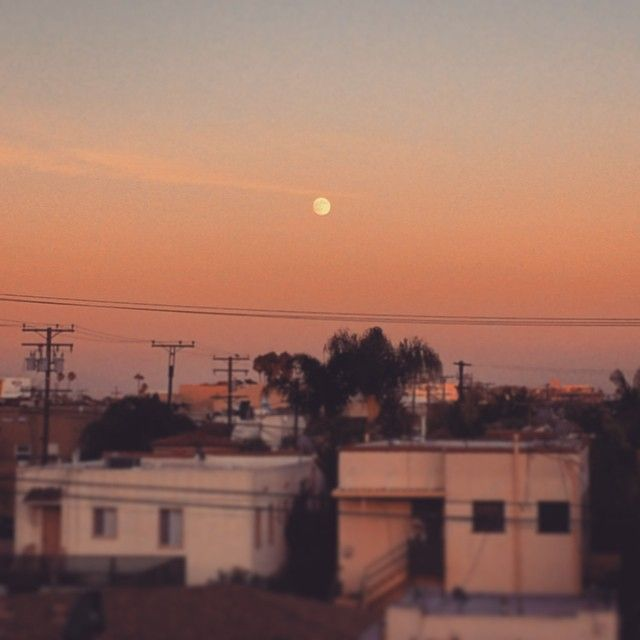 Moonrise in Belmont Shore. Sunset reflecting in the evening sky. A Southern California beach town.