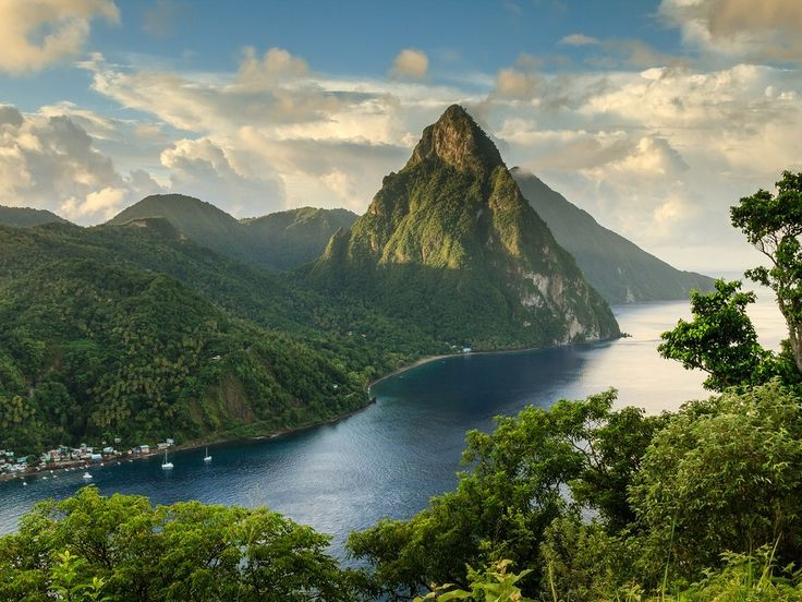"""Nature doesn't get more photogenic than St. Lucia's Pitons, two mountainous volcano spires on the southern end of the island. Covered in lush rainforest and luxurious resorts, the Caribbean country is a popular honeymoon spot.Pro tip: Check out Anse Cochon (""""Bay of Pigs""""), accessible only by boat, to swim, dive, or snorkel over an unspoiled reef and a shipwreck.Getting there: A number of U.S. airlines fly direct to St. Lucia from hubs like Atlanta and Miami. Catch a ferry in Castries to take…"""