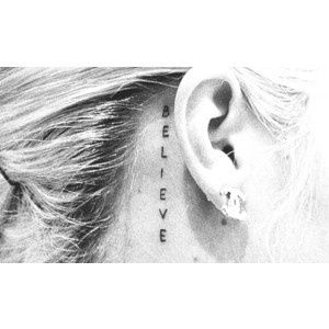ear tattoo, believe. & no, this has nothing to do with Justin Bieber. lol