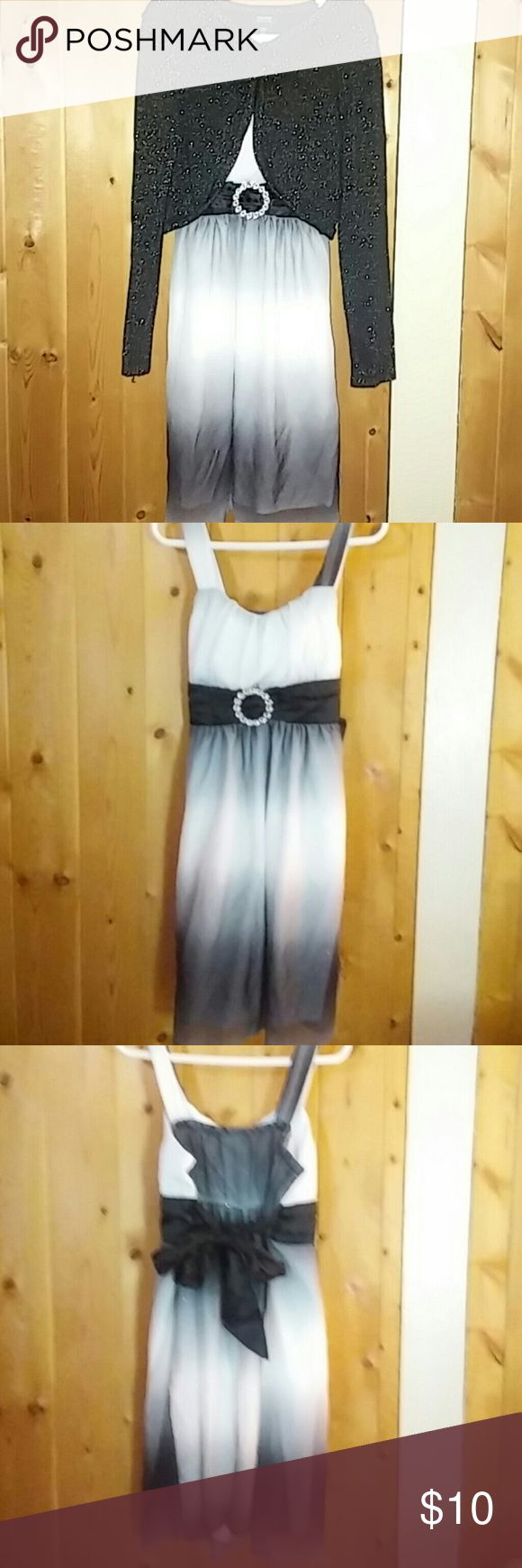 Dress and cardigan Ombre black and white dress with sparkles and ties in the back that comes with a sparkly black cardigan size 7/8 only worn once Holiday Edition Dresses