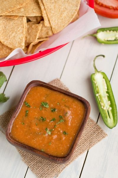 A recipe for the red sauce you find in Mexican restaurants in squeeze bottles, perfect for smothering your burritos, for taco sauce, for any type of Mexican food. It's also great as a flavorful salsa.
