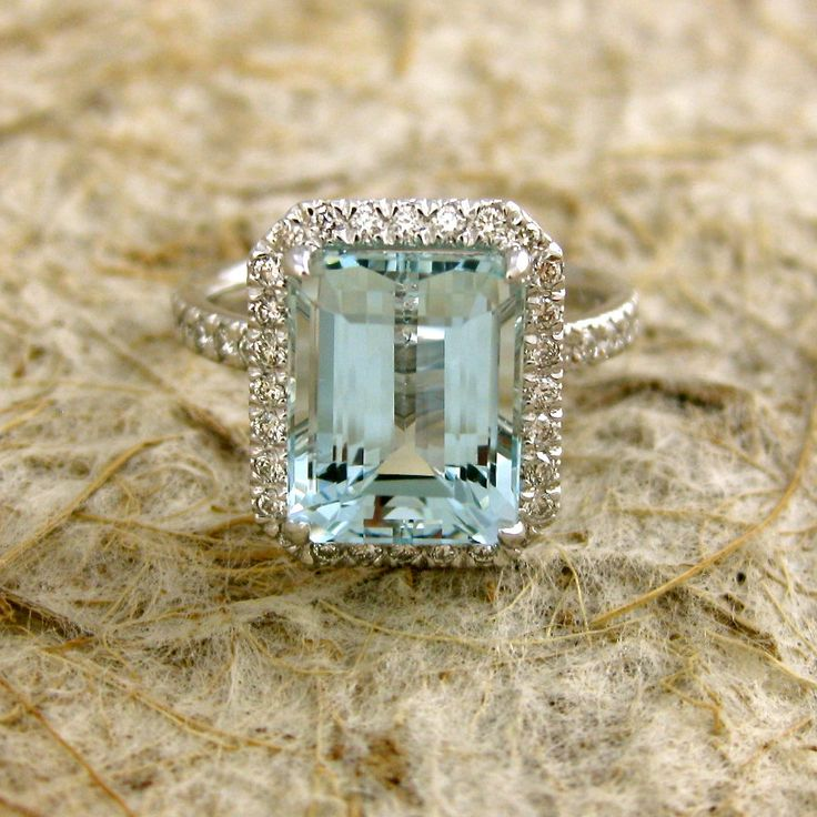 Light Blue Green 4.24ct Emerald Cut Aquamarine 18K White Gold Engagement Ring with Diamonds Size 6.5. $3,450.00, via Etsy.