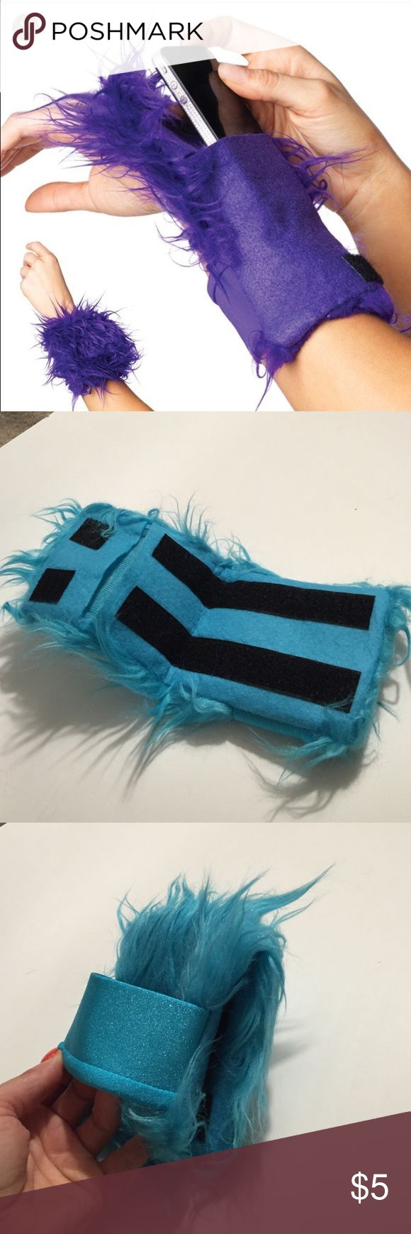 Furry wrist wallet! Rave ready! Easy way to hold phone and wallet! Never used! Tags removed. Needs a new home! Happy to bundle with other items for bigger discount! Leg Avenue  Accessories