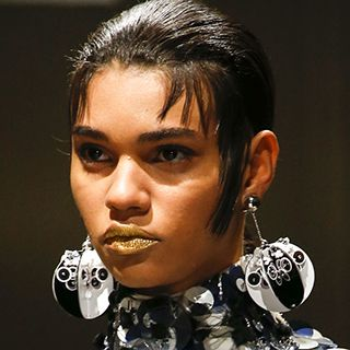 Pendant #earrings used as #accessories in #Prada Spring Summer #2016 Collection reminded the audience of New Year's. #inspiration #fashion #fashionweek #trends #design #dicoballs