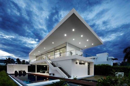 huge sloping flat roof modern home design