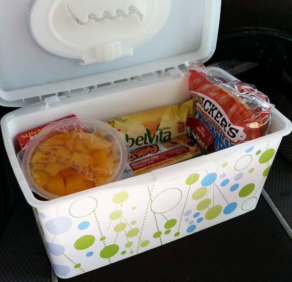 Use an empty wipes container to store travel snacks for you kids.