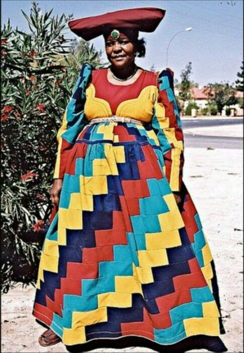 We are highlighting the Herero people in Namibia. The Herero women adopted the German missionaries' Victorian-style floor length gowns, but eventually incorporated the vivid colors and cow-horn-shaped headdress to represent the Herero's respect for cattle. After a woman is married, she is expected to make most of her dresses, often from the offcuts of other garments. #facttuesday #fashion #bloggers #madeinafrica #culture #tradition #Namibia #color #herero #dress #africa