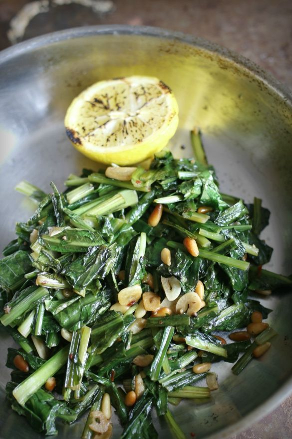 rge bunch dandelion greens, rinsed of dirt and rough chopped with stems 2 tablespoons olive oil 5 garlic cloves, sliced thin 1 teaspoon crushed red pepper 1/2 cup vegetable broth 2 tablespoons pine nuts Juic