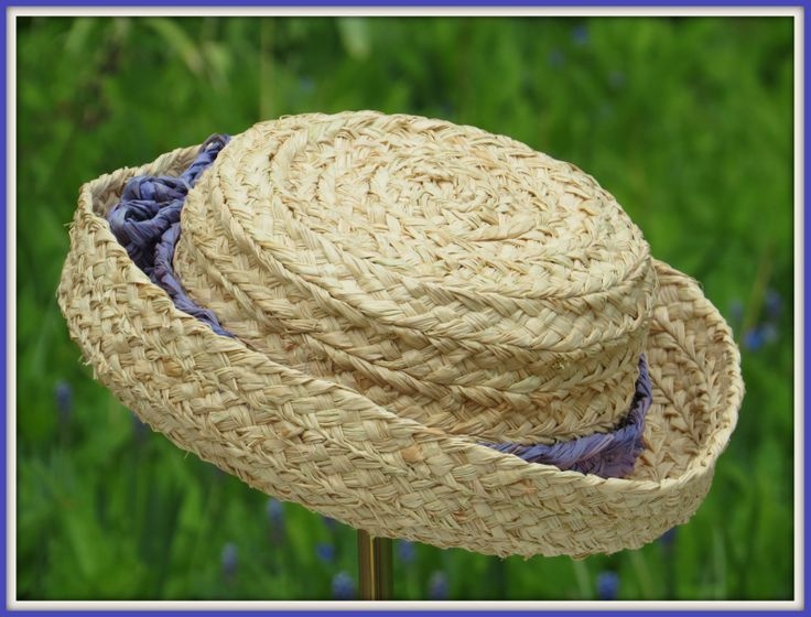 Childens' hat. Ribbon matching the blue spring flowers, material and production matching responsability for the future.