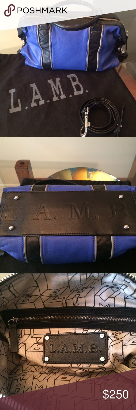 Gigi 2 Leather Duffle Bag Cobalt blue and black leather. Two handles and optional shoulder strap. One inner zipper pocket and two slot pockets for cell phone. L.A.M.B. logo and metal feet on bottom of bag. Purchase include dusk bag. L.A.M.B. Bags Shoulder Bags