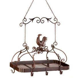 """Keep your kitchen organized with this farmhouse-inspired pot rack. Crafted of iron, this versatile design offers an array of hooks for your cookware and a top storage rack for lids and accessories.   Product: Pot rackConstruction Material: IronColor: Distressed rust redFeatures: Scrolling designDimensions: 34"""" H x 23"""" W x 15.75"""" D (including chain)"""