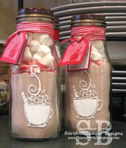 I saw something almost exactly like this at Hallmark the every day and had a light bulb moment.  I can drink 4 Frappuccino's, get a wicket caffeine buzz and make these!  I just stamped and embossed the images directly onto the bottles.    ** check out my blog at www.barefootstamper.com