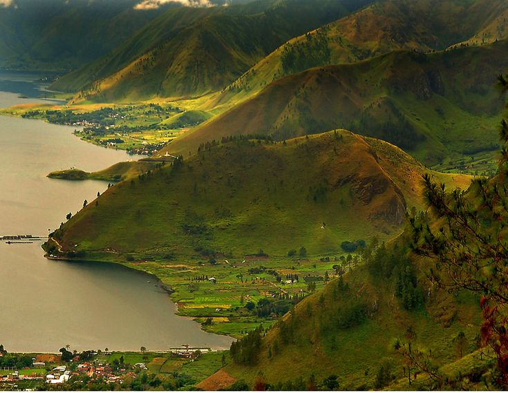 Lake Toba, Indonesia. Such a beautiful place to sit n paint n draw all day. however i had a hard time finding internet here. so i climbed the mountains n roads n stuff n there was this place, it was like an internet cafe, and charged about 3 dollar per 30 minutes or something like that. LOL!