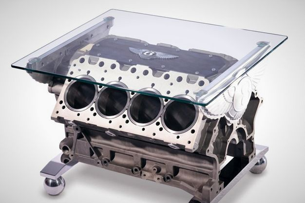 Talk about upcycling– this stunning table is made from a powerful Bentley V8 engine.