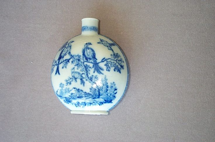 "A very rare late Caughley bottle or flask. Decorated  underglaze with the ""Birds in Branches"" pattern and a fretted key type border to the neck. Unmarked   Curca  1795   Height  5"""