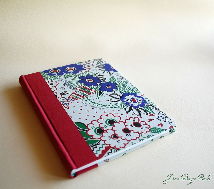A little notebook with red cloth and flowery paper.