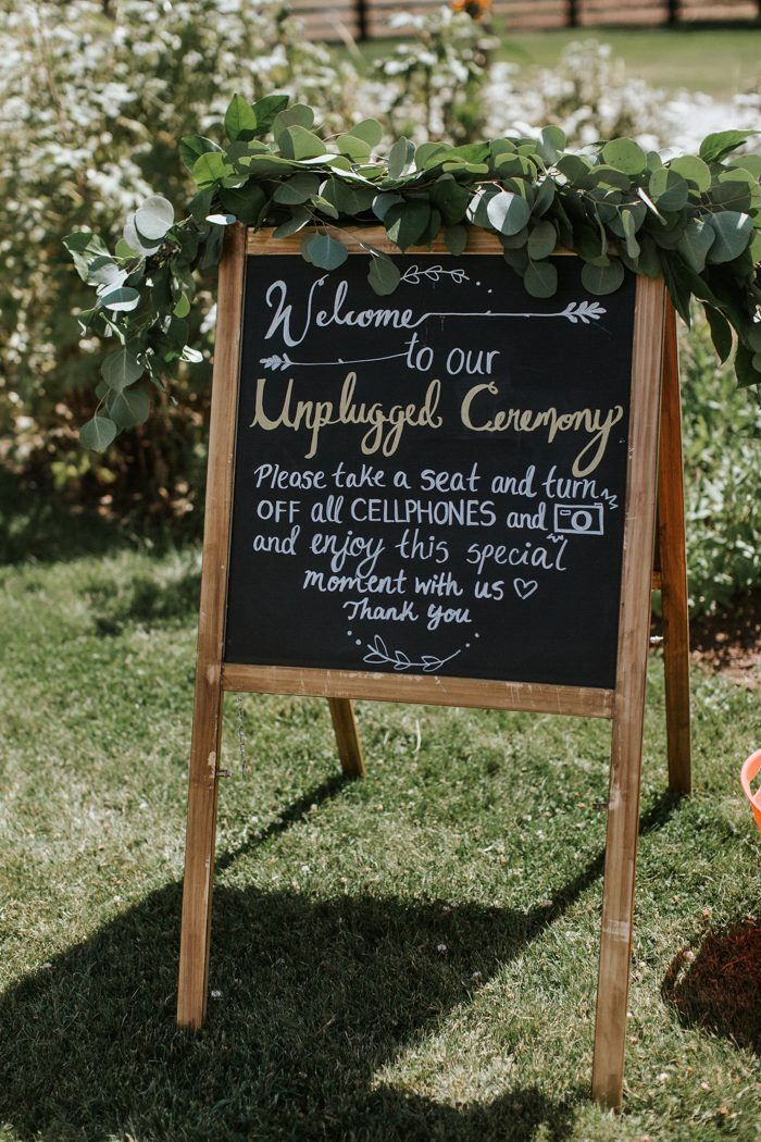 Love this 'unplugged ceremony' rustic handwritten signage with floral decor| image by The Jar Photography   #rusticweddinginspo #elegantweddinginspo #weddingphotoinspiration #weddingphotoideas #floraldecor #reception #weddingreception #weddingreceptioninspo #receptioninspiration #receptiondecor #receptioninspo #finishingtouches #weddingdecor #weddingsign #signage #handwrittencalligraphy