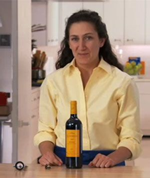 To open wine, all you need is a classic waiter's corkscrew, no bells and whistles. This video shows the easy how-tos for how to open wine properly. | Real Simple