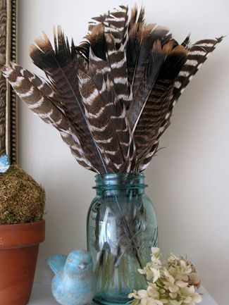 Feather-filled vase made out of a mason jar and patterned feathers. More great ideas for using feathers to great effect. For feathers visit: http://www.thefeatherfactory.co.uk/