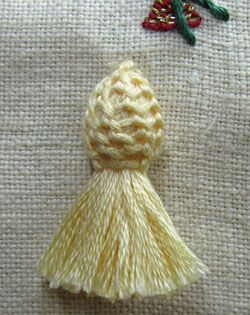 Buttonhole stitch top on a tassel - written instructions supported by photos of how to make this tassel.
