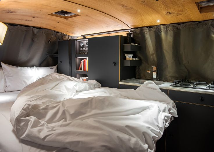 German designer Nils Holger Moormann has transformed a Volkswagen T6 bus into a home away from home by using a careful choice of materials and colours