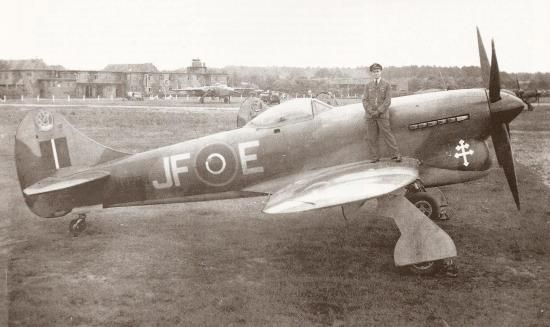 "Pierre Clostermann with Hawker Tempest JF-E  ""Le Grand Charles"" (SN222). 27 August 1945."