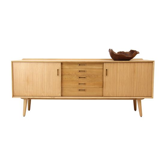 Nordic Buffet 5 Drawer Dimensions: 200 x 50 x 75h cm Material: European Oak Finish: Natural Stain  The attention to detail and the quality of the craftmanship ensure these pieces will become family heirlooms.  The buffet features 2 x sliding cupboard doors with removable internal shelves and 5 storage drawers.  (Assembly of legs to buffet required - easy screw in